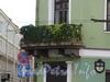 Наб. канала Грибоедова, д. 23 / пер. Сергея Тюленина, д. 4. Угловой балкон. Фото август 2010 г.