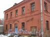 Адрес дома (г.Санкт-Петербург, участок ж/д Варшавский вокзал-М.Митрофаньевская ул., литера Л),но может быть и 116 по наб. Обводного канала. Фото март 2012 г.