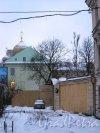 Наб. Лейтенанта Шмидта, дом 21. Вид участка дома со стороны дома 19 по набережной Лейтенанта Шмидта. Фото 31 января 2013 года.