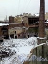 Наб. реки Карповки, д. 27, лит. Б. Демонтаж строений на участке. Вид со стороны дома 53/22 по Каменноостровскому проспекту. Фото 02 февраля 2014 г.