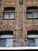 Угловой пер., д. 7. Доходный дом Н. И. Львовой («Дом со свастикой»). Фрагмент орнамента фасада. Фото февраль 2010 г.
