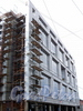 Певческий пер., д. 12. Работы на фасаде строящегося здания. Фото апрель 2011 г.