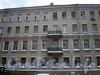 Греческий пр., д. 25 / 8-я Советская ул., д. 1. Бывший доходный дом. Фрагмент фасада по проспекту. Фото декабрь 2009 г.