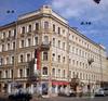 Суворовский пр., д. 9 / 4-я Советская ул., д. 18. Бывший доходный дом. Общий вид здания. Фото август 2009 г.