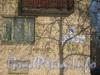 Пр. Народного ополчения, дом 245. Новая табличка с названием улицы и номером дома и остатки старой надписи. Фото февраль 2012 г.