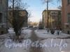 Проход со стороны Отечественной ул. до Ириновского пр. Между дом 39, корпуса 1 и 2(слева) и домом 41, корпуса 1 и 2 (справа). На заднем плане 1-ые корпуса, на переднем - фрагменты 2-ых корпусов. Фото февраль 2012 г.