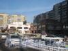 Индустриальный пр., дом 9. Торгово-развлекательный комплекс на Индустриальном пр. Слева - дом 11 корпус 1, справа - дом 9. Фото февраль 2012 г.