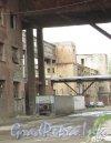 Комплекс зданий мясокомбината им. С.М. Кирова («Сампсон»).  Московское шоссе, дом 13, лит. БА. Фрагмент фасада здания. Фото май 2011 года.